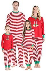 Image of a family wearing elf pajamas