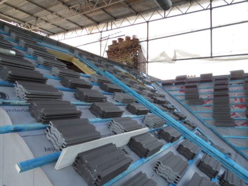 Stacked roof tiles on rafters