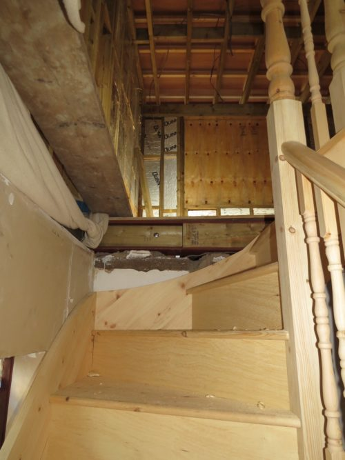 View of installation of loft stairs going up into conversion