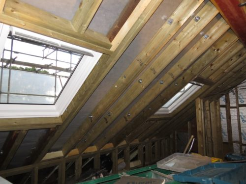 View of velux windows in rafters (front of house)