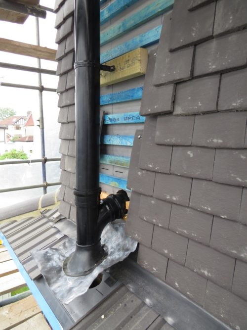External view of soil pipe installed to side of roof