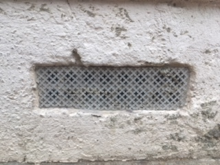 Air brick covered using aluminum radiator cover and clear mastic