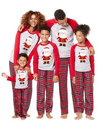 Image of family wearing santa inspired pyjamas