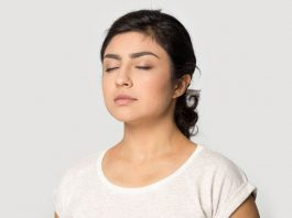 Image of woman breathing with her eyes closed