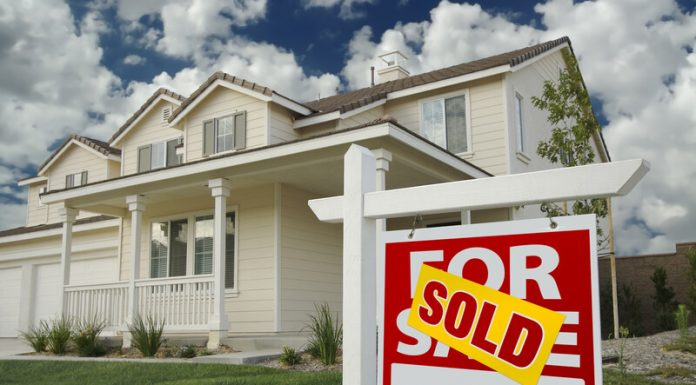 Image of a property with a sold sign