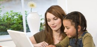 Image of a parent homeschooling her child
