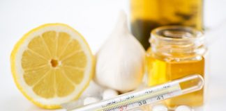 Image of a thermometer, lemons and honey