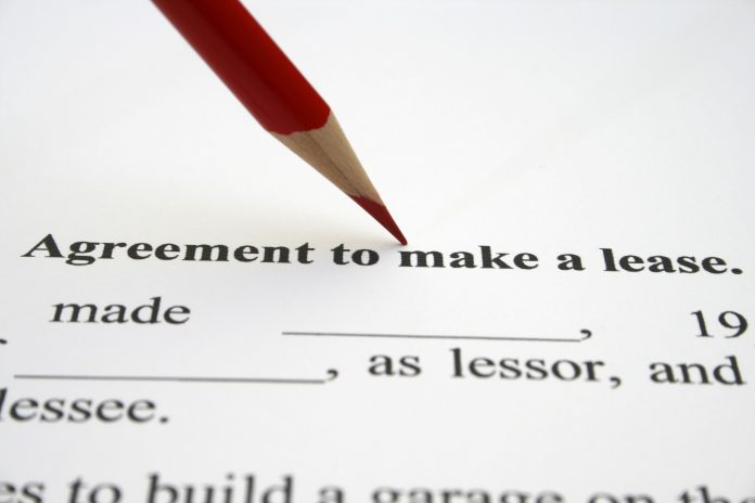 Image of a pencil on a lease agreement